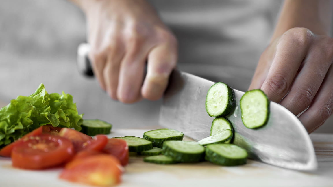 hands chopping vegetables