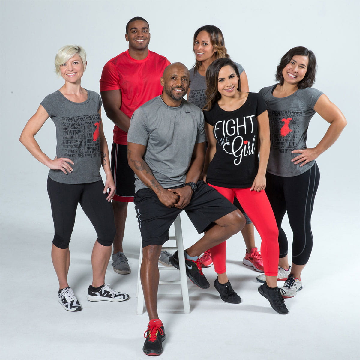 Group portrait of diverse adults in athletic attire