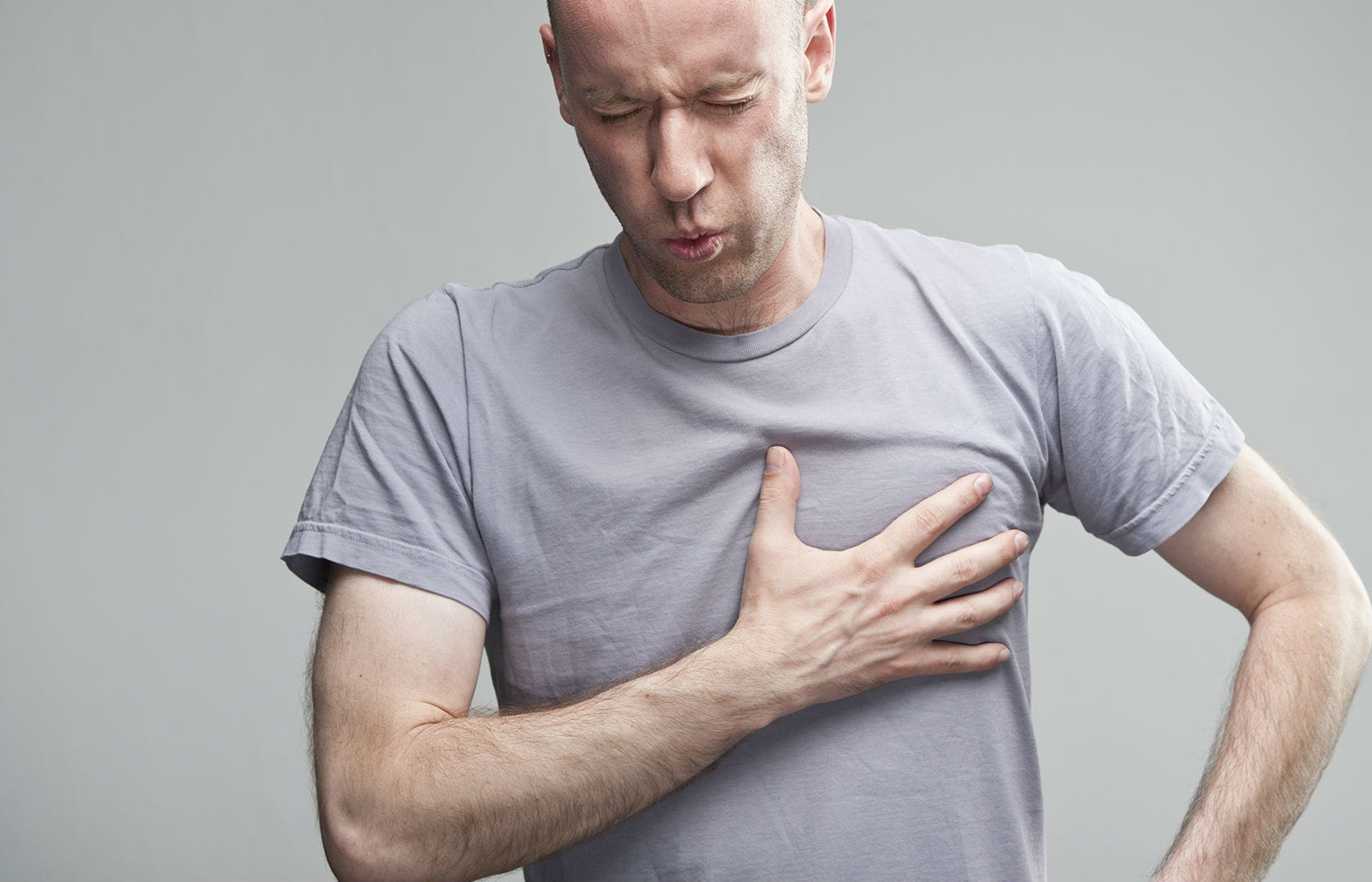 Man clutching his chest in pain