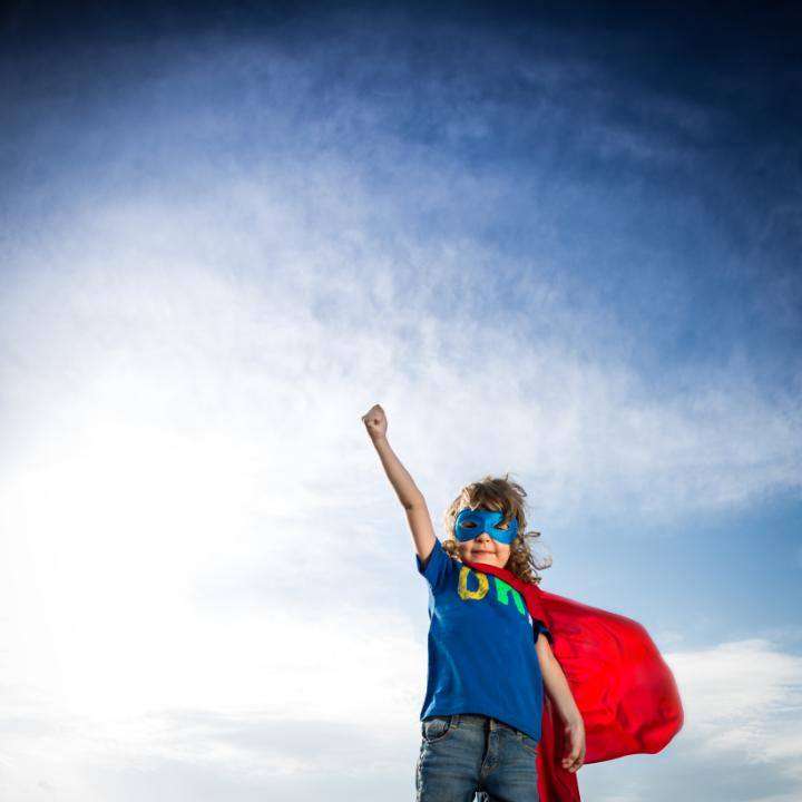 Superhero young boy