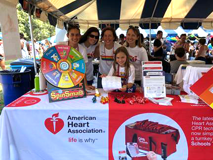 Group smiling at Heart.org tent event