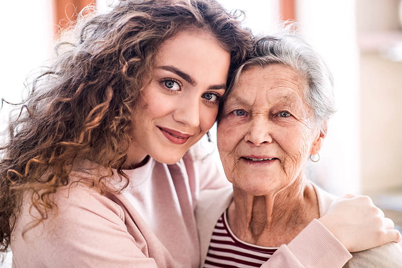 portrait of young woman with grandmother
