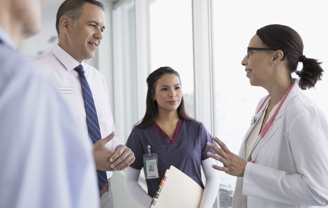 Two doctors and a nurse having a discussion