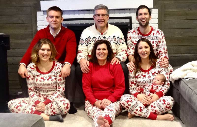 Jim Abraham with family in Christmas pajamas