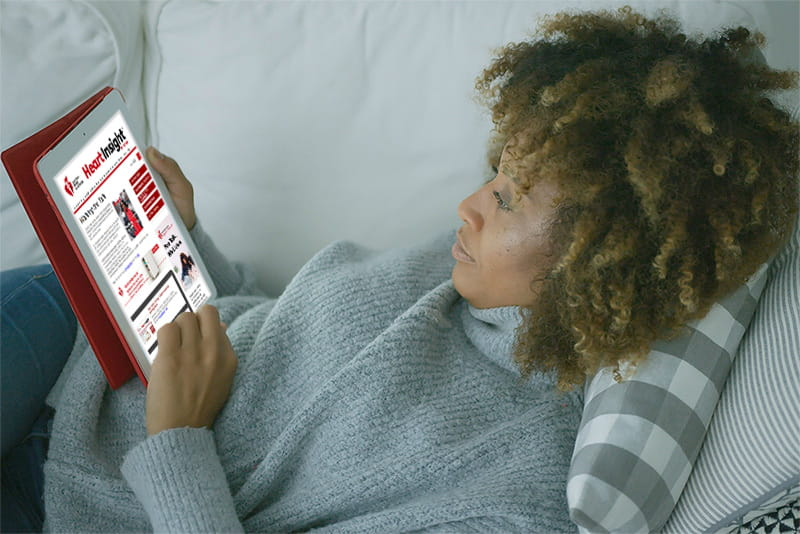 Woman reading Heart Insight on her tablet
