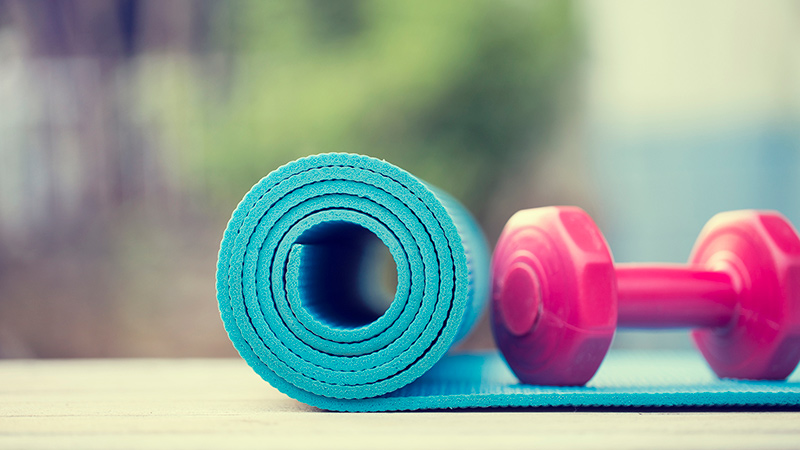 yoga mat and hand weight
