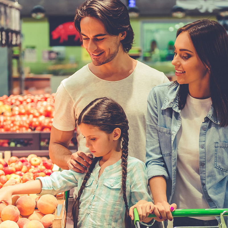 Family in produce section