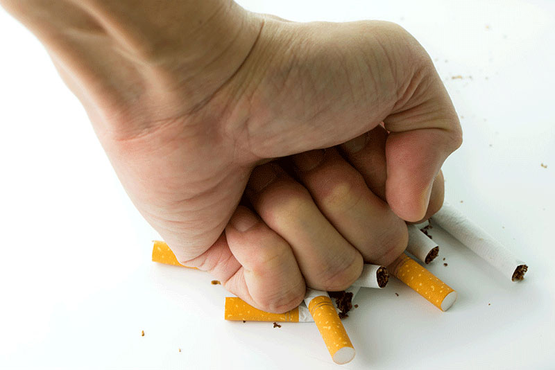 Quit Smoking Hand Smashing Cigarettes