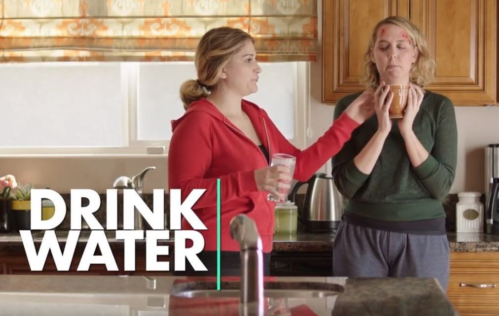2 women drinking  water