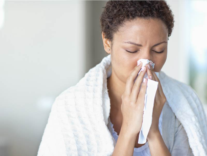 Woman sick with flu.