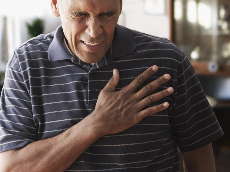 African-American man clutching his chest. (iStock)