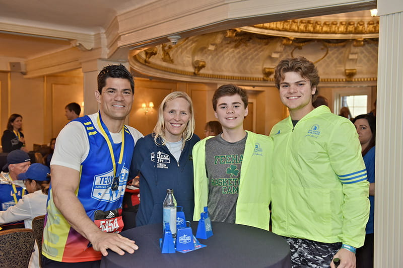 From left: Tedy Bruschi, his wife Heidi, and sons Dante and Rex. (Photo courtesy of Stacy Smith Studios)
