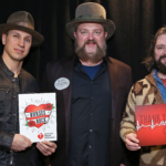 Coy Bowles, Jimmy de Martini and John Hopkins of the Zac Brown Band say thank you to nurses. (Photo by Getty Images)