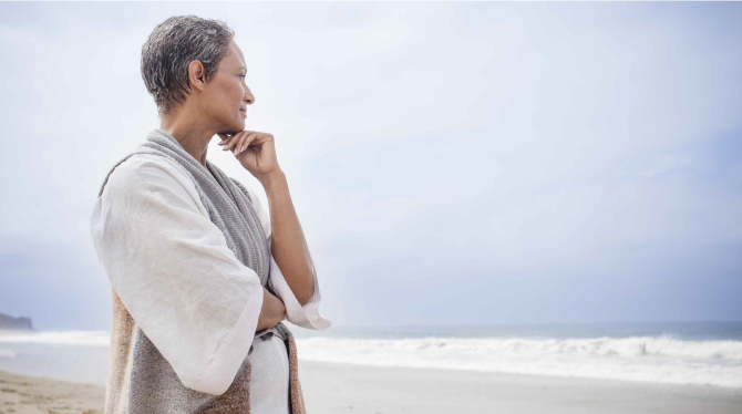 Older woman gazing at beach