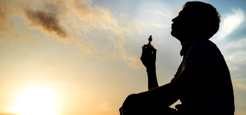 silhouette of someone vaping