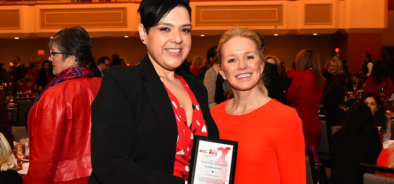 Annabelle Jimenez (left) received the New York Lifestyle Change Award from Macy's executive vice president Molly Langenstein at the 2018 Go Red For Women Luncheon in New York City. (Photo courtesy of Annabelle Jimenez)