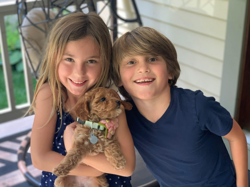 Charlie Timmel (right) and his sister Ella with their new puppy in July 2020. (Photo courtesy of the Timmel family)