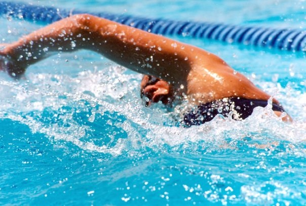 Stroke survivor Tara MacInnes competes for her swim team in May, 2004. (Photo courtesy of Tara MacInnes)