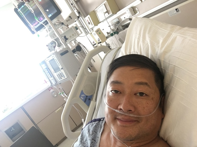 Dave Kim recuperates in the hospital after his stroke. (Photo courtesy of Dave Kim)