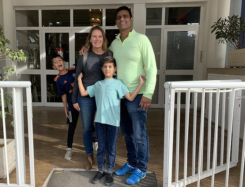 Alec Ahmad (left) with his brother Abel and parents Angela and Kamran in 2019. (Photo courtesy of Angela Grinstead Ahmad)