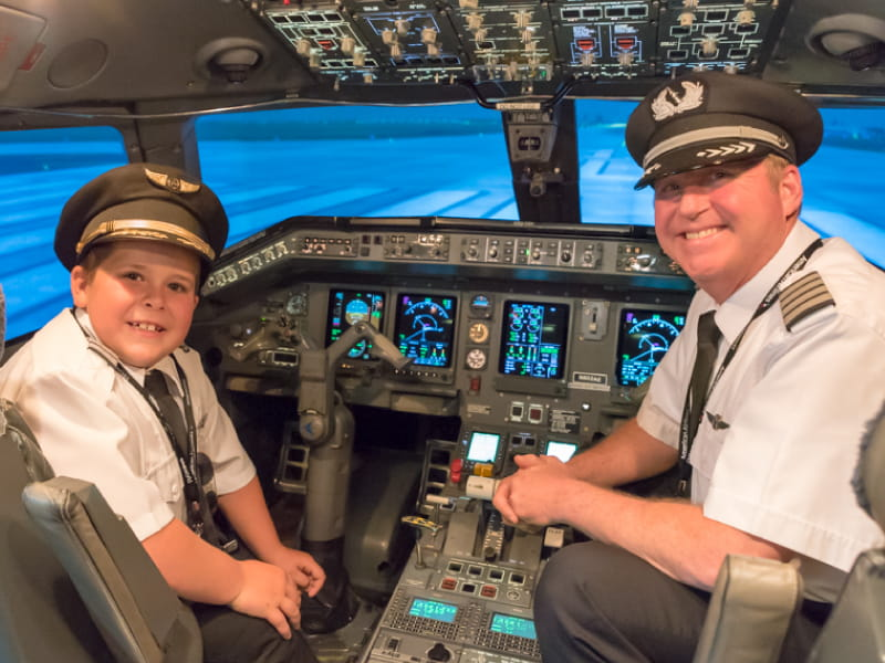 Easton Fryer joins Ric Wilson, VP of flight operations for Envoy Airlines, in the cockpit. (Photo courtesy of Envoy Airlines)