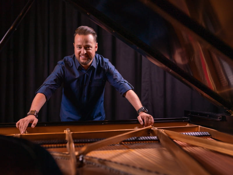 Pianist Paul Cardall was born with a congenital heart defect, and he now heals others' hearts through his music. (Photo by Erin Morris Huttlinger)