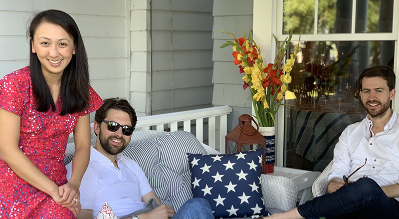 Bonnie's family lounging on the white wicker couch on the porch facing Chautauqua Lake. (Photo courtesy of Bonnie Gwin)