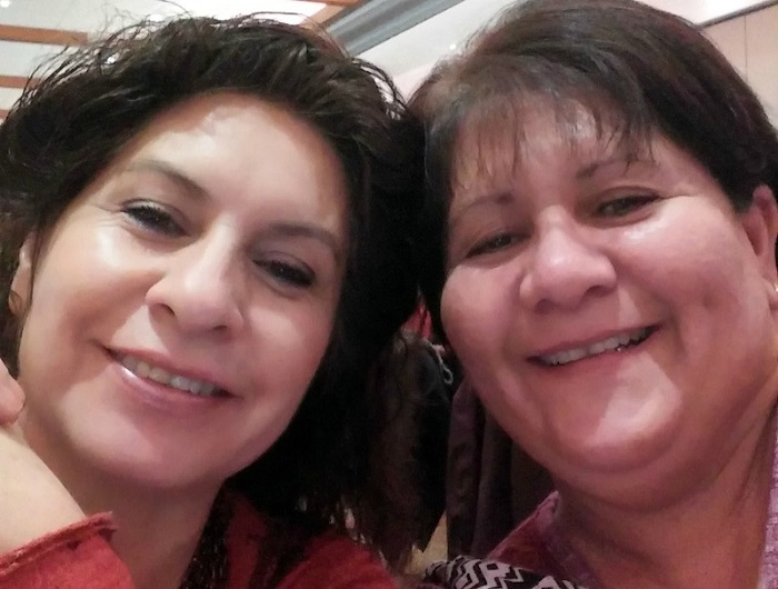 Heart attack survivor Barbara Marquez (right) with her sister Yolanda at a Go Red For Women Native American event in 2017. (Photo courtesy of Barbara Marquez)