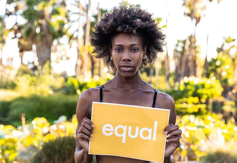 Woman holding Equal sign