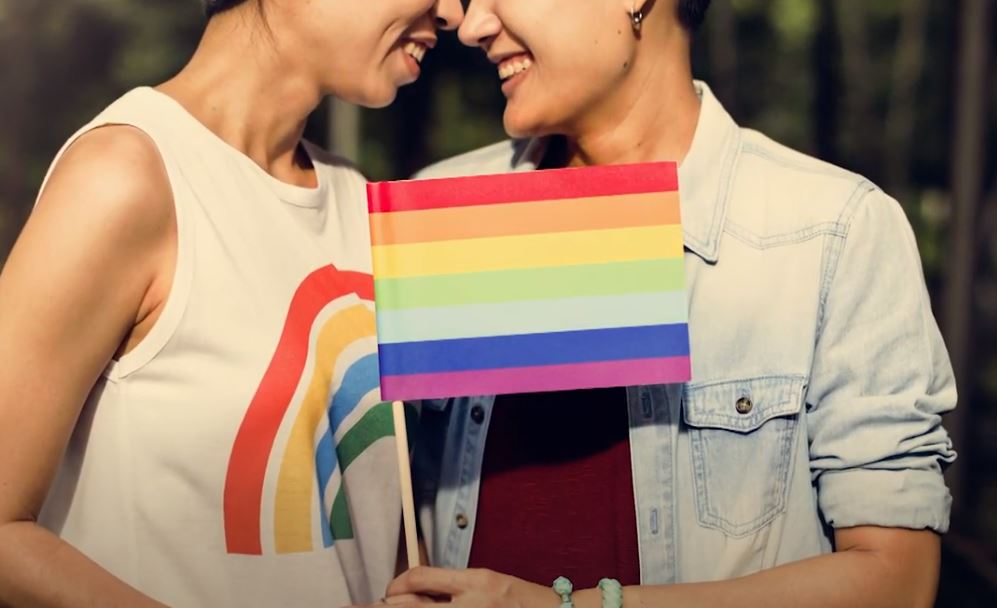 two women and a rainbow flag