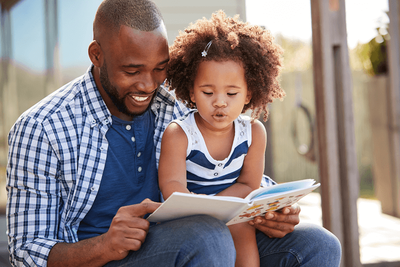 Young Father Reading to Daughter
