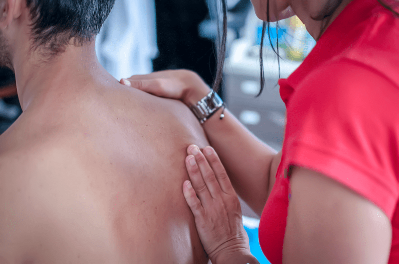 Therapist working on a patient's shoulder