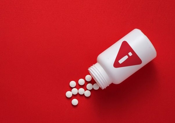 Pills on a red background