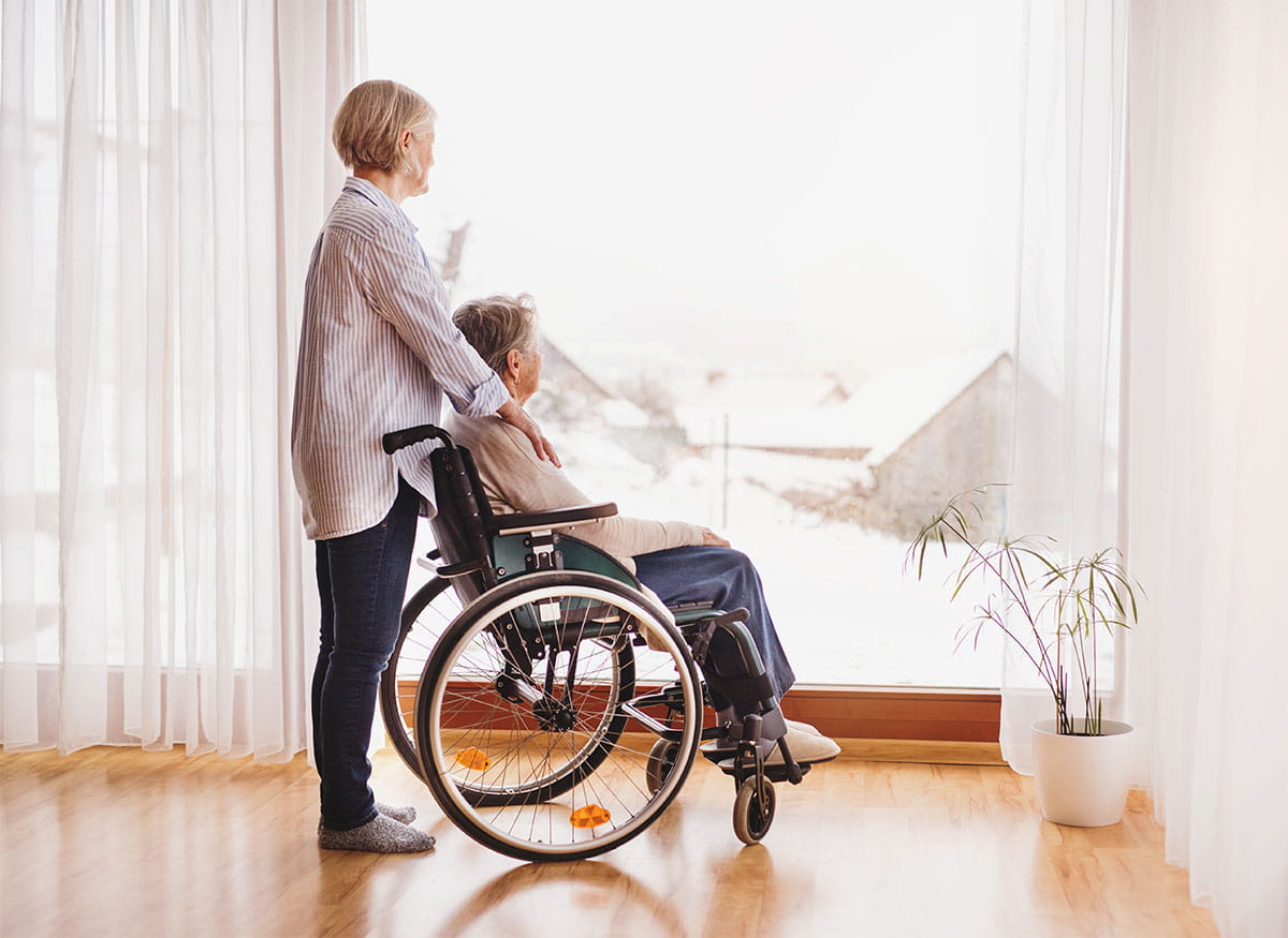 woman with wheelchair at home