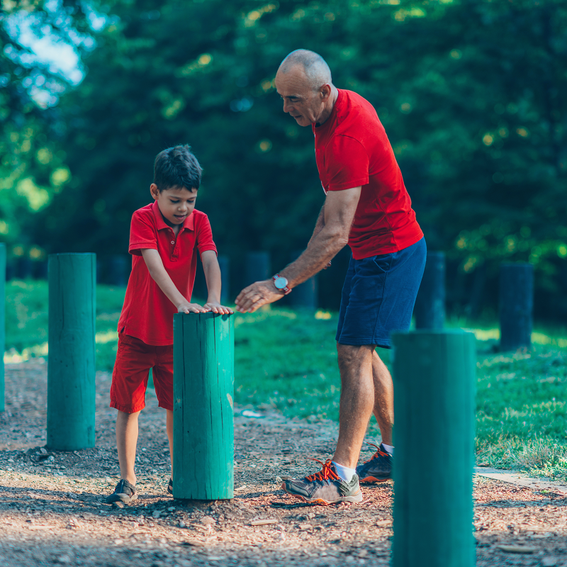Grandfather and Grandson exercising in the park