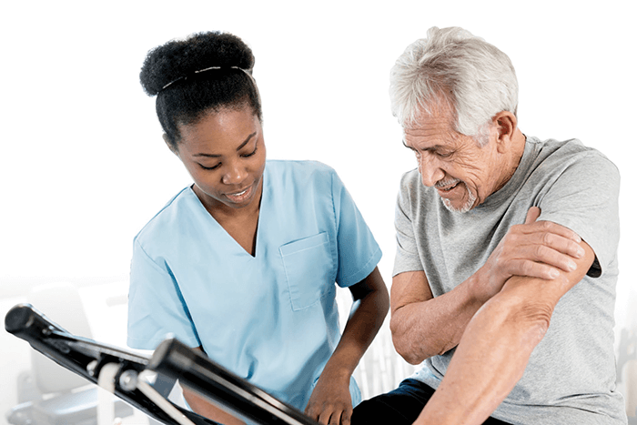 Rehab doctor helping older male patient