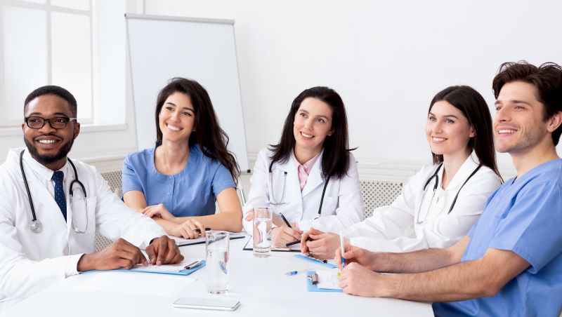 group of medical professionals sitting around a table