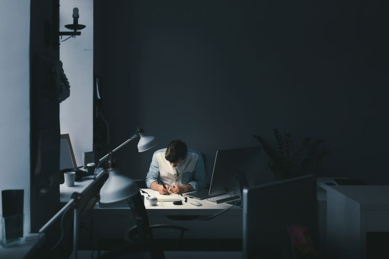 Person working in a dark office