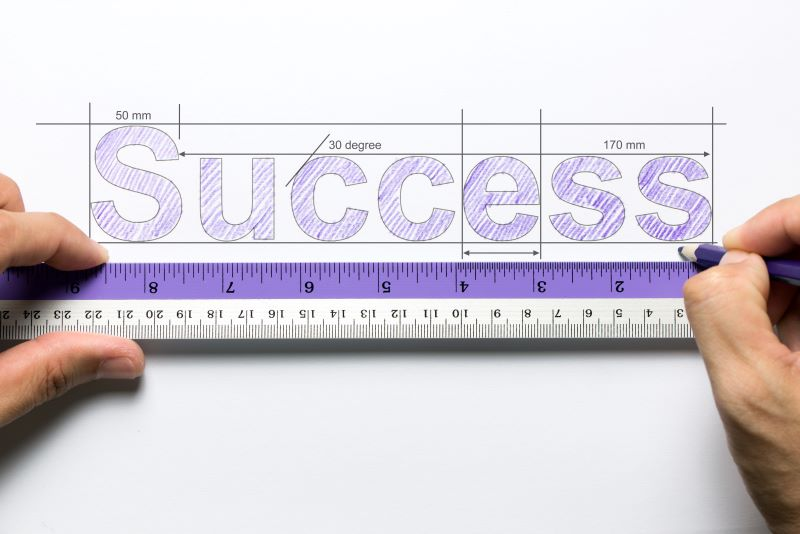 the word success written above a ruler