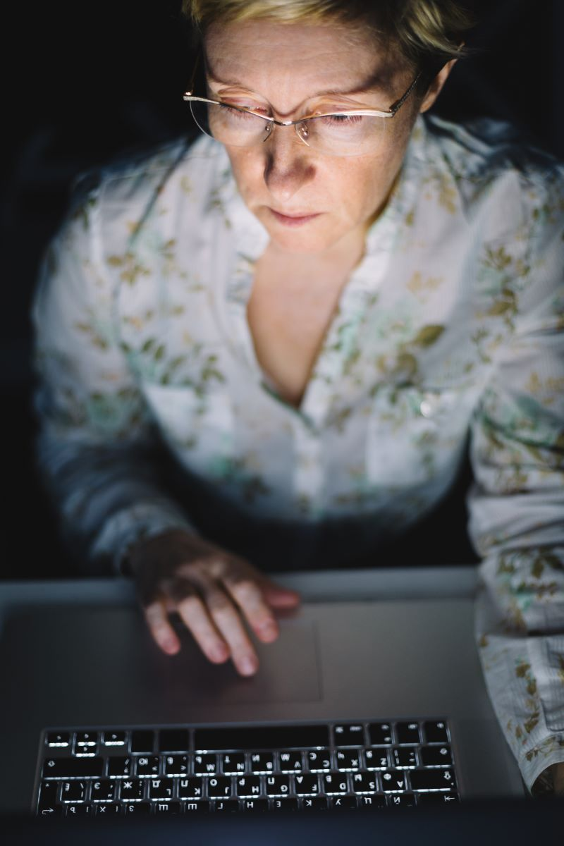 Middle Aged Woman Working on a Laptop