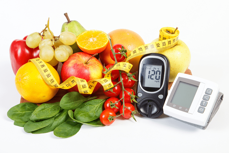 Fruit, tape measure, blood pressure machine and glucose monitor