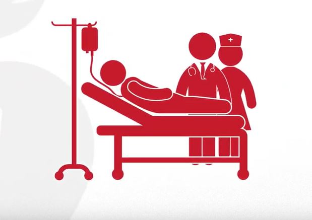 drawing of a patient in a  hospital bed with staff around them