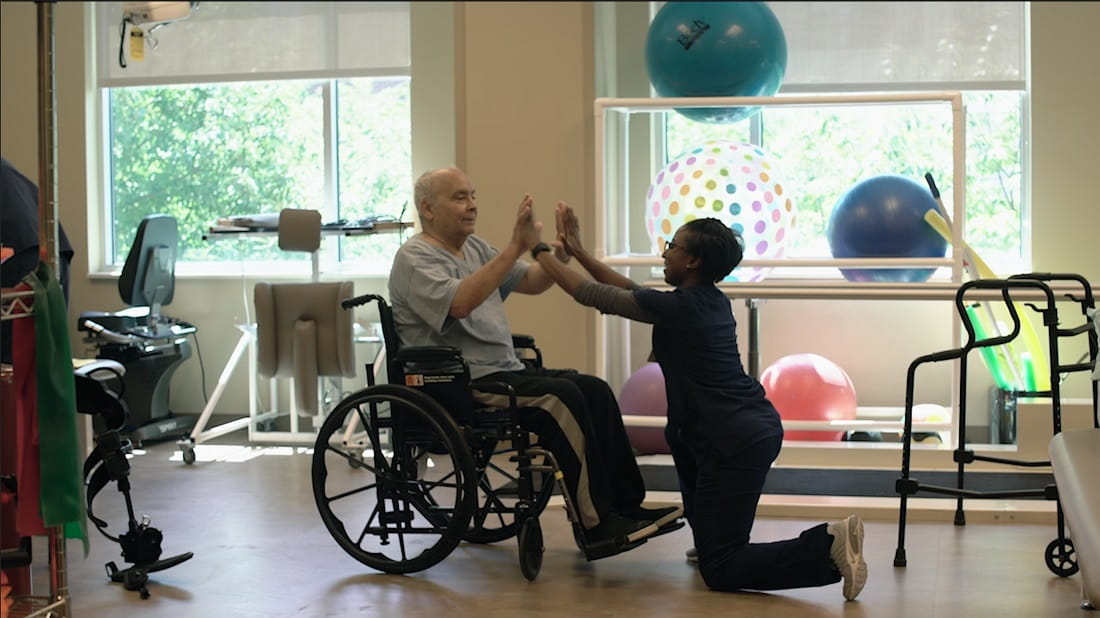 patient engaging with rehab professional