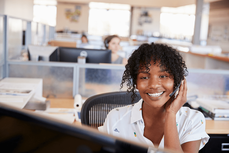 woman working in a call centre answering phone